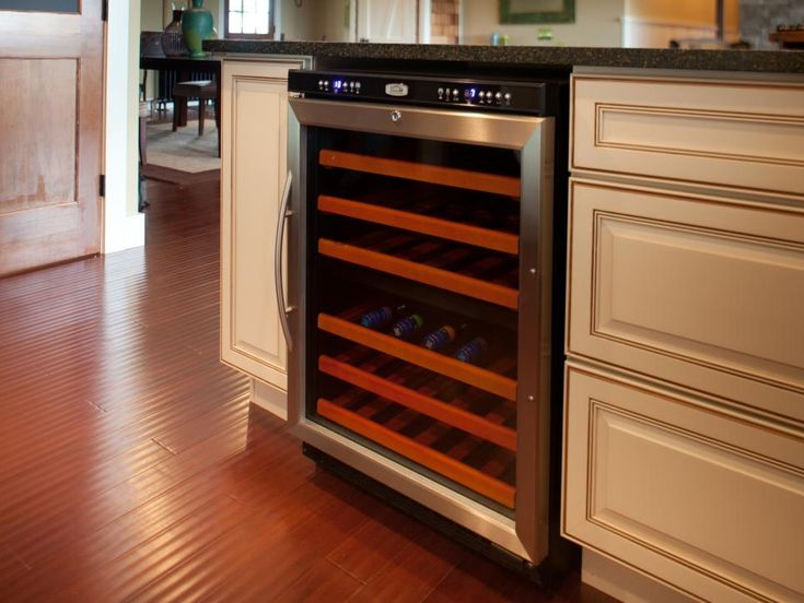 Splurge, if you can. Select one specialty item that says something about your entertaining style. An under-counter wine cooler, a microwave/warming drawer combo or custom countertop appliance will also lend a touch of contemporary style to your vintage kitchen.