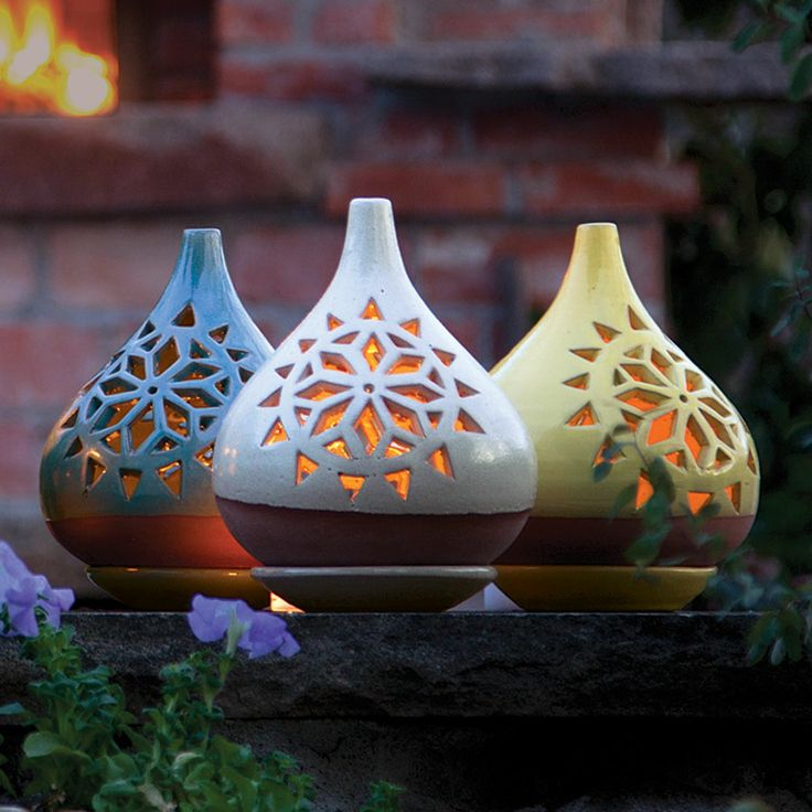 Egyptian Lanterns  Made by hand in a centuries-old pottery workshop in Egypt's Old Cairo, these pierced and glazed ceramic lanterns cast a romantic glow. Each is two pieces: a tray to hold the candle and a top to shield it from breezes. Use indoors or out; bring indoors for winter.