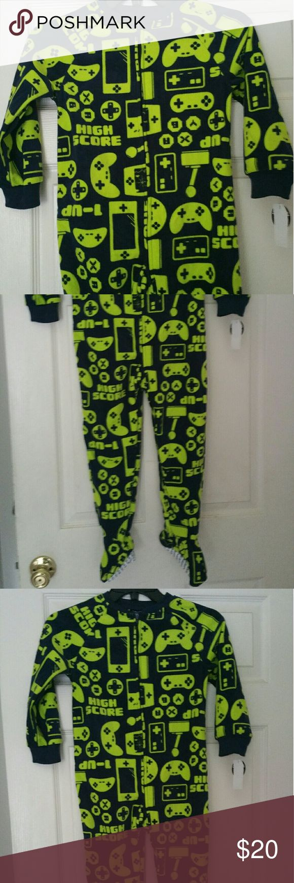 PRICE DROP!! BOYS FOOTED BLANKET SLEEPER PAJAMAS Day or night, these boys' footed sleeper pajamas will keep him cozy from head to toe. Made from soft microfleece, these one-piece PJs are not only warm, they also feature a colorful  print & Flame Resistant. A full-length zipper makes dressing easy, while textured logo grips on the attached feet prevent accidental slips. Joe Boxer Pajamas
