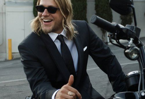 Charlie Hunnam. Man on a bike = sexy. Man in a suit = sexy. This man, on that bike, in that suit. I'm done!