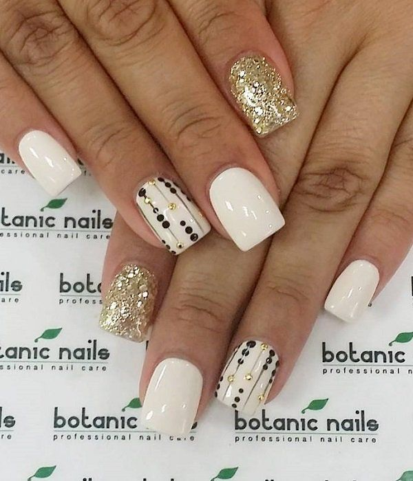 White and gold with a touch of black looks fantastic and go with almost any colored dress. Pamper your nails with this neat design.