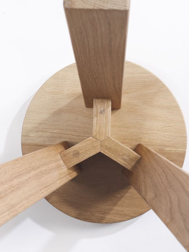 The base of this three legged table shows some seriously sturdy construction. This design would be great for bar stools.