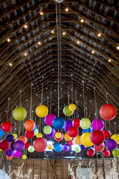 How amazing is this? Love the pops of color these #lanterns bring to a #rustic #barn wedding {Andrew Morrell Photography}