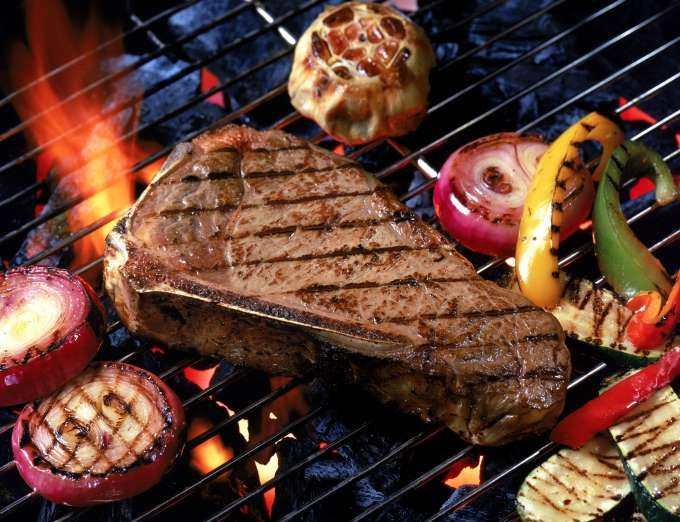 Steak with vegetables on grill - Dennis Gottlieb/Getty Images