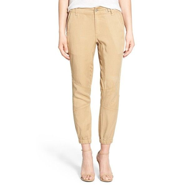 Pam & Gela High Rise Grommet Detail Jogger Pants ($225) ❤ liked on Polyvore featuring pants, khaki, jogger pants, high waisted jogger pants, zipper jogger pants, white khaki pants and high-waisted trousers