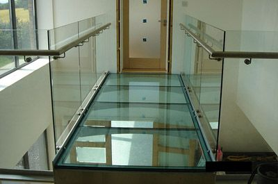Glass for floor panels can be used to make a transparent floor cladding which allows light to enter the area below. Glass flooring also adds a part of sophistication to the ambience.