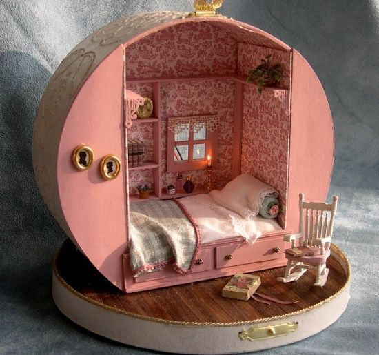 Miniature dollhouse made from a hat box (via in a box )