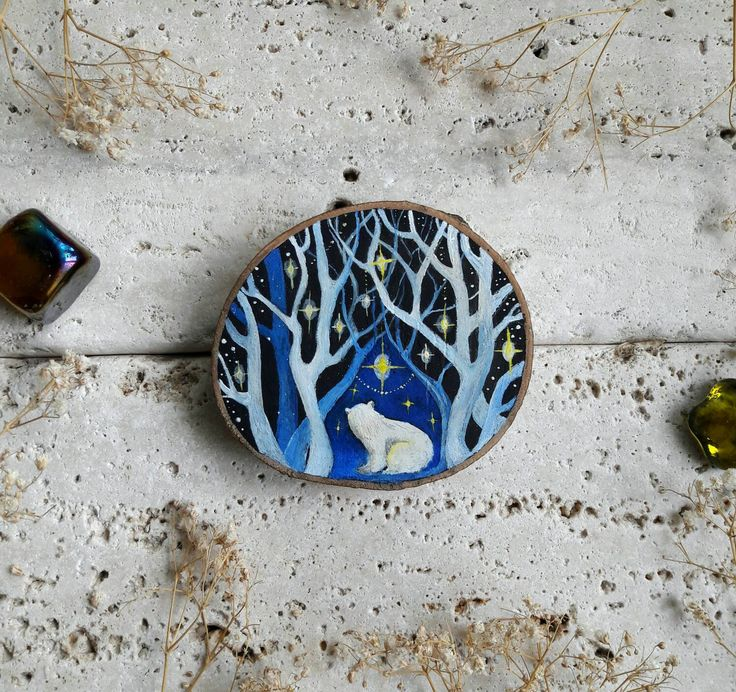 polar bear cub in magic ice forest painted on natural and recycled wood slice with bright acrylic colors and refined with transparent sealant to ensure color durability over the time #polar #bear #wood #slice #painting