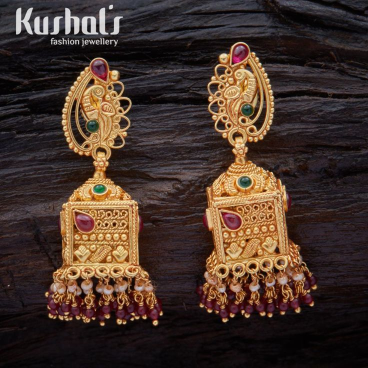 Dress up in the festive mood with this pair of handcrafted South Indian Traditional Silver Temple Jewellery Earrings with an intricate design decorated Ruby Green Hanging Beads & Studded with spinal stones. the entire piece is crafted in pure Silver (92.5)