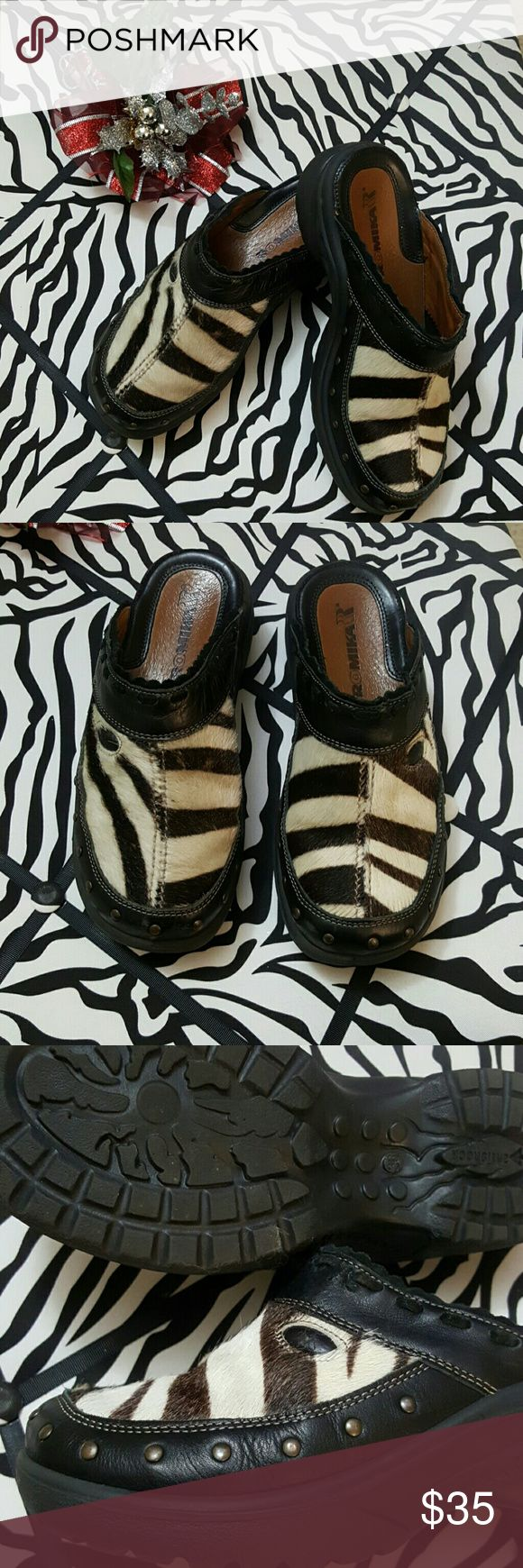 ROMIKA ZEBRA PRINT CALF HAIR MULES SIZE 6 OMG YOU HAVE TO HAVE THESE!! They are SOO MUCH FUN!! They are in great new like condition except for a little blemish in the 3rd pic in the leather along the stitching. These fit more like a 6.5.. I wear a 6 and I would have to wear thick socks or they were too big and even then.. these wild beasts just wouldn't tame to my feet! The metal brass studded detail around the toe bed makes them even more edginess. They were made to be worn and not caged up…