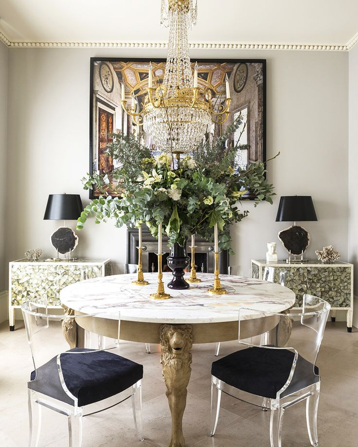 traditional dining room marble oval round table gold lion carved table legs black ghost chairs decor inspiration glam chanelier black lamps