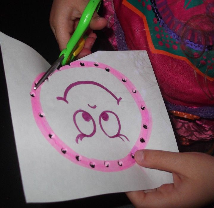 punch holes using lite brite then cut through holes with scissors
