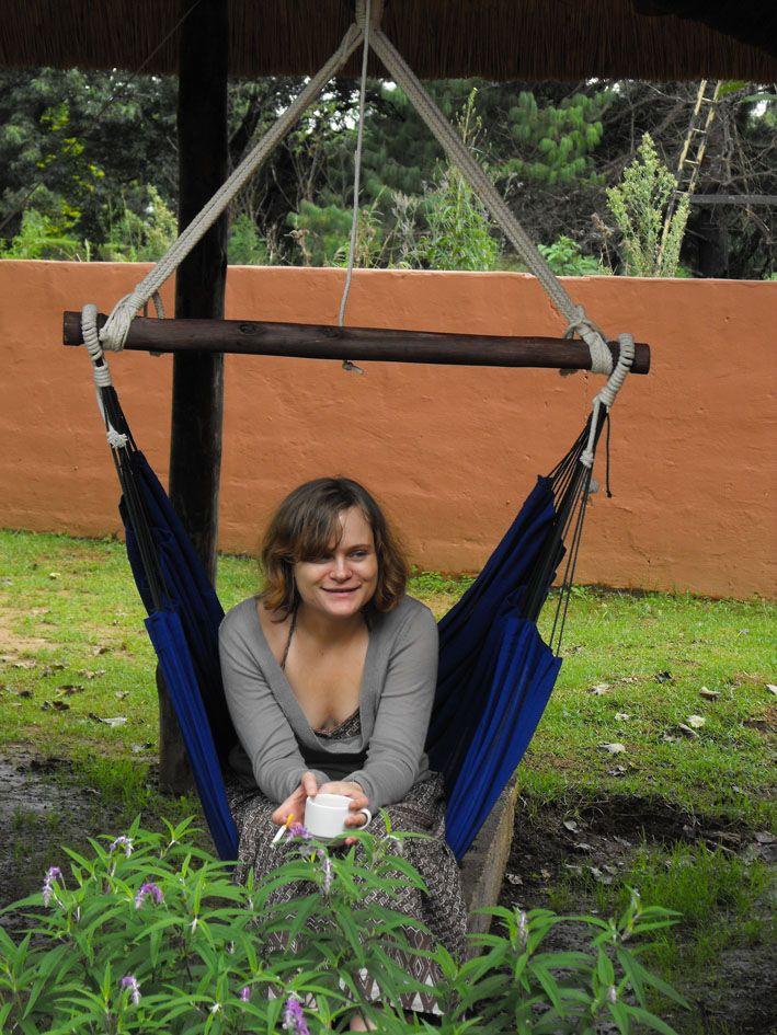 www.dreamtimehammocks.co.za - the blue sitting Dreamtime hammock hangs easily off a patio beam.