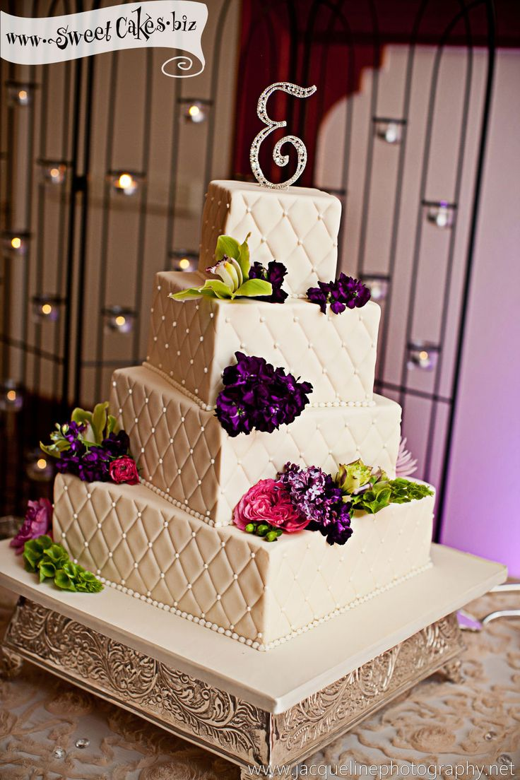 4 tier square wedding cake with diamond quilting and fresh flowers topper with a rhinestone monogram cake topper  flowers: Ambience Floral  photo: Jacqueline Photography
