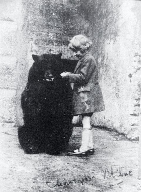 "Christopher Robin Milne and Winnipeg ""Winnie"" the Bear at London Zoo, ca. 1926....'Winnie the Pooh'"