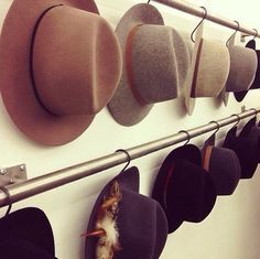 8. HATS . Storing hats so that they don't get smushed is super important! Hanging them rather than stacking them is the best bet for preserving your beautiful brimmed hats for as long as possible! via They All Hate Us