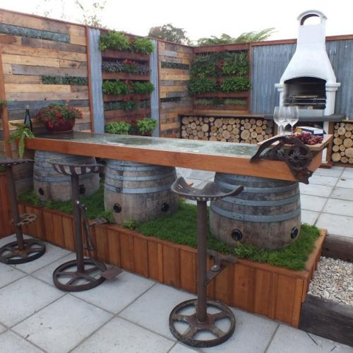 Bars and bar leaners are a great way to maximize space in small garden designs. H & S Landscape Design - Ellerslie Flower Show 2013