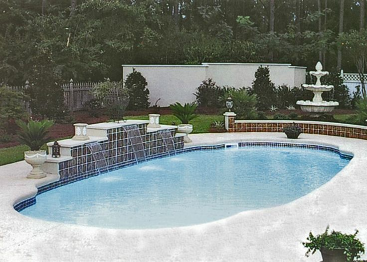 Blue hawaiian fiberglass pool with water feature and seat for Pool design hawaii