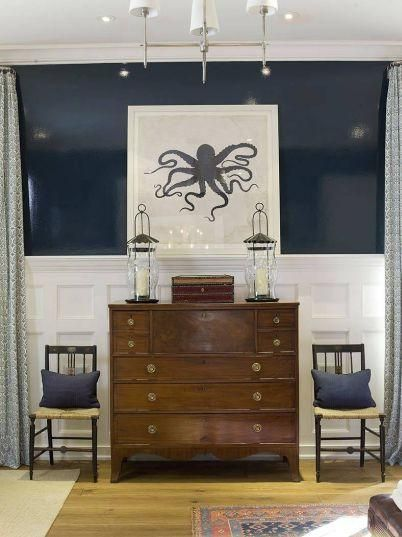 High gloss navy walls, dark wood chest, chairs flanking chest: Wall Colors, Dining Rooms, Octopuses Art, Idea, Beaches House, Blue Wall, Octopuses Prints, Navy Wall, The Navy