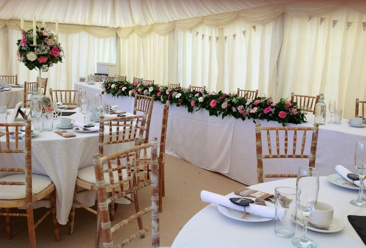 Pink and cream vintage wedding flowers in a marquee in Leicestershire