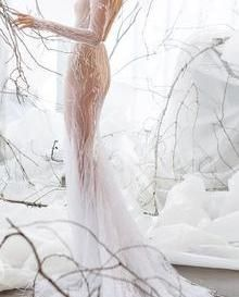 A beautiful and rather daring bridal gown using Juliana Lace