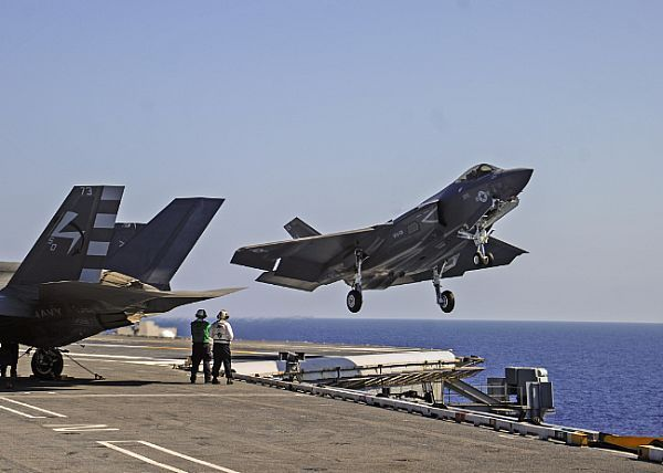 An F-35C Lightning II carrier variant, assigned to the Grim Reapers of Strike Fighter Squadron (VFA) 101, the Navy's F-35C Fleet replacement squadron, performs a touch-and-go on the flight deck of the aircraft carrier USS George Washington (CVN 73).