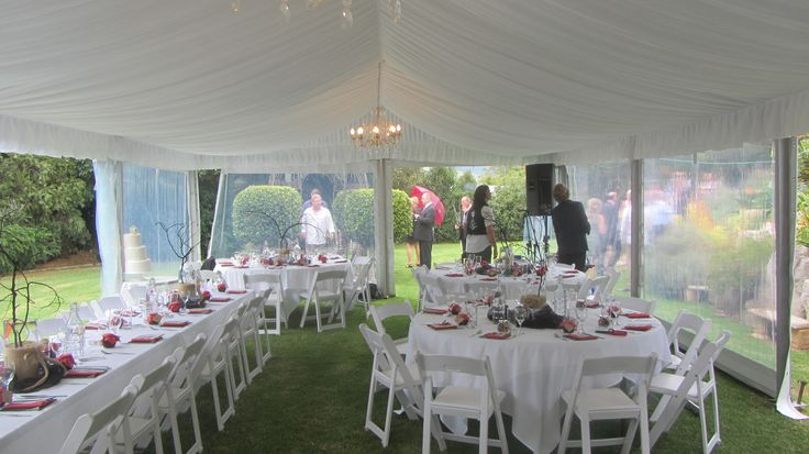 silk lining, chandeliers, 6m marquee structure, clear walls, round tables, white padded folding chairs, south coast weddings, south coast party hire