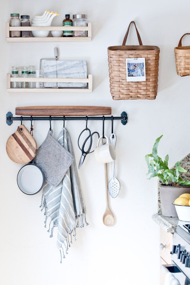 Hanging rail provides handy kitchen storage and adds visual interest | Design*Sponge