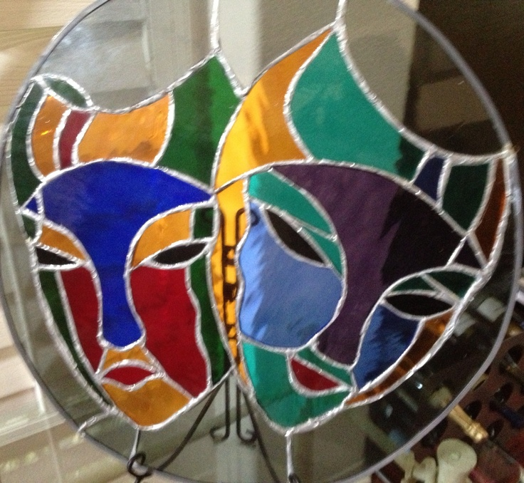 Stained glass theatre masks.