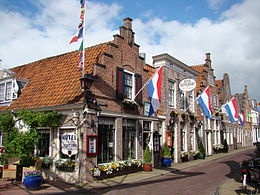 Edam, province of Noord (Holland), the quintessential Dutch town delineated by canals with manually operated bridges, quiet with the sounds of carillons, lovely with its beautifully designed buildings and spaces, and welcoming lace curtains and smiling faces everywhere
