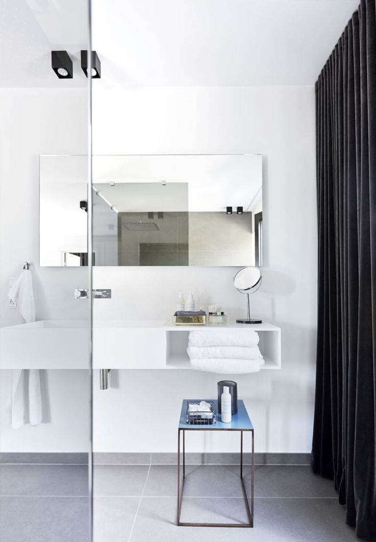 Clean lines and white beauty in this bathroom.