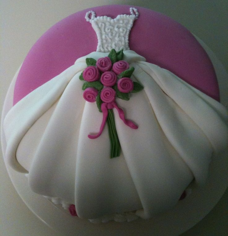 Fondant covered cake with fondant dress and rose details - comments say pleating fondant not so easy!
