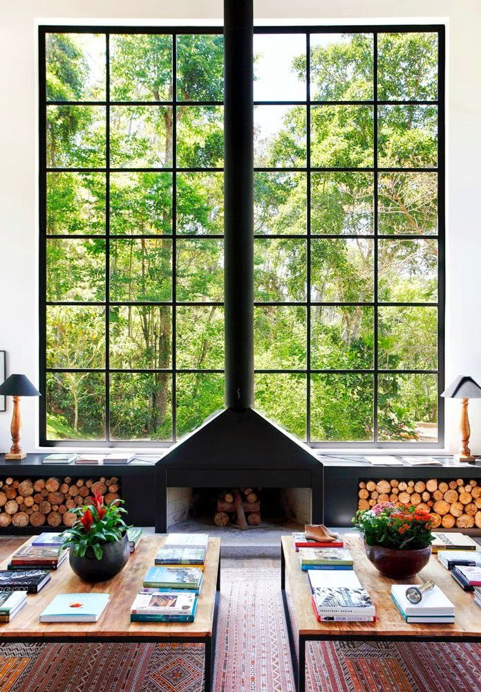 I love the unique combination of the black steel of the windowframe and fireplace