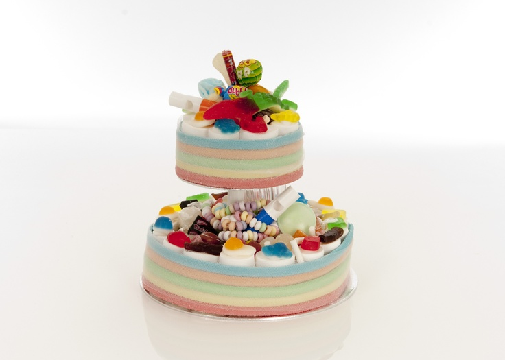Two tier rainbow sweetie cake available from http://www.chocolateumbrella.co.uk/