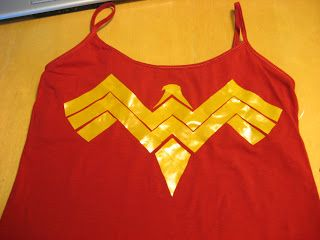 Transform your red shirt into a DIY Wonder Woman Costume with yellow tape!