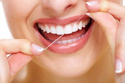 You already know that flossing keeps your teeth and gums healthy, but that little spool of white stuff also protects your heart, your joints, and can even help you lose weight. Here's how flossing benefits more than oral health! #healthbenefitsofflossing