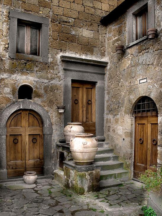 Three wood doors. I especially love the arched double door!