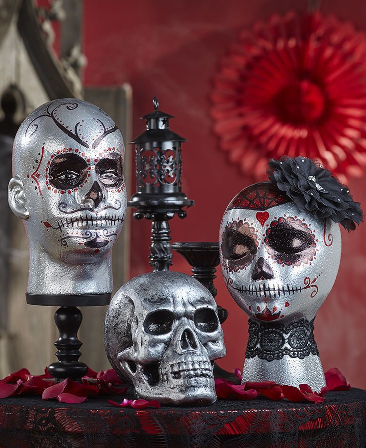 tutorial for turning styrofoam mannequin heads into day of the dead display - Halloween Display Ideas