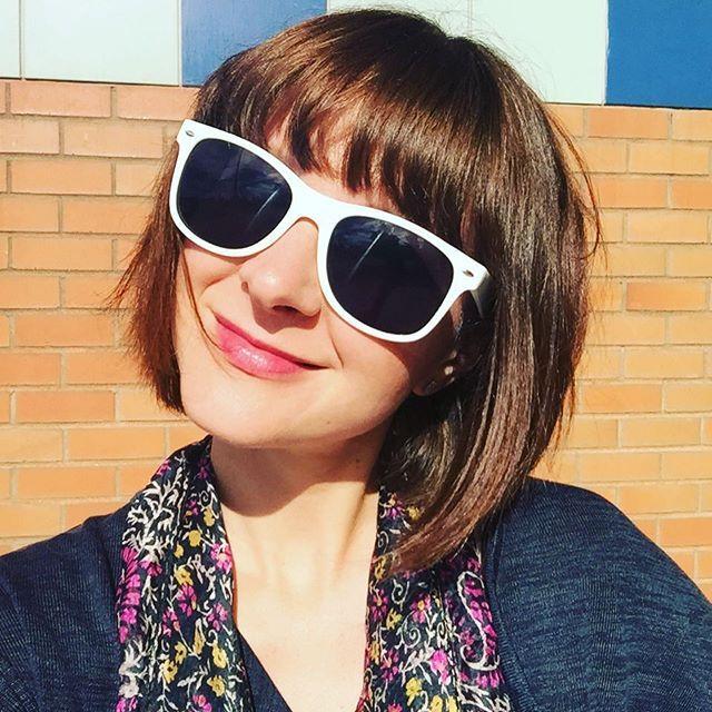 Good day sunshine :sunny: Sunny day selfie. White sunglasses, brown bob haircut with bangs, silk scarf, brick wall.