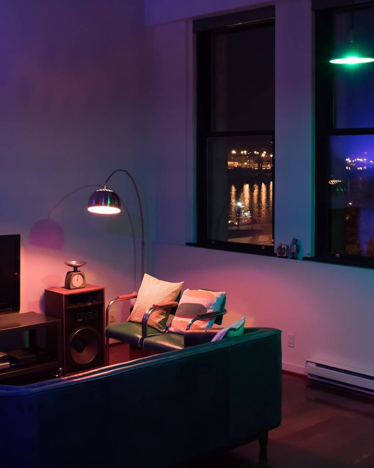 Set the mood of your living room with Lumenari bulbs for those unforgettable moments.   #SetTheMood #interiordesign #retrodesign #midcenturymodern