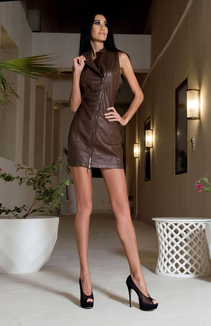 To recreate this catwalk look, try the Hot Chocolate cocktail dress. A soft brown leather look dress, this takes the Louis Vuitton runway style and gives it a modern twist. The stud details and long zip kick this Mod dress into the present day, team with 60's style pointed flats to keep a Mod them to your look.