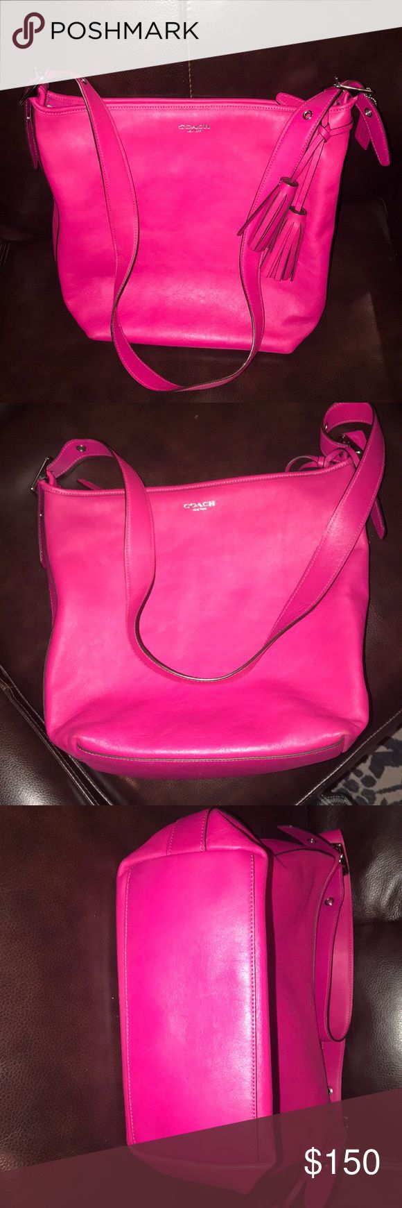 Coach Legacy hot pink large duffel satchel tassels Large duffle style crossbody from the Coach Legacy series. Hot pink leather. Tassels . It is large . Has two small marks on front- see photo. Inside is clean - a few pen marks- see  photos. Overall in excellent condition.  A great bag Coach Bags Crossbody Bags