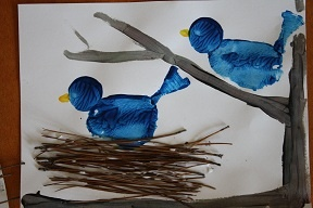 painting project using branches for the nest.  The birds are potato prints.