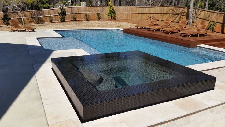 Modern pool with tile infinity edge spa our freeform for Pool jacuzzi design