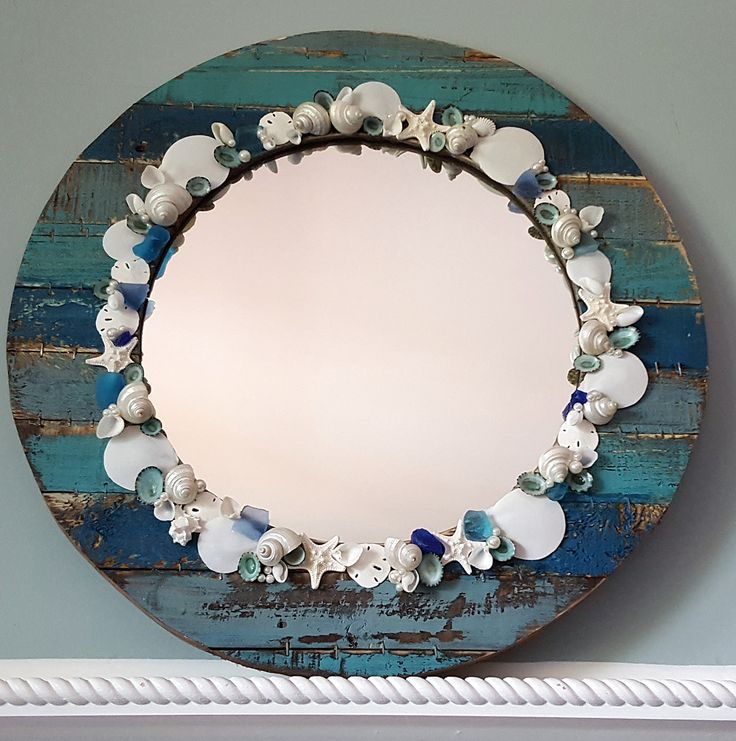 Beach decor seashell mirror, nautical decor shell mirror, coastal decor seashell watercolor barn wood round mirror with shells, starfish & pearls.  $125.  https://www.beachgrasscottage.com/