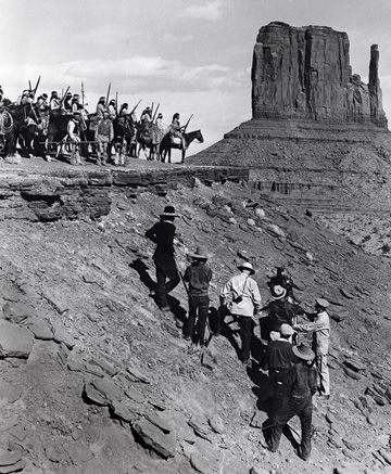 """On location in Monument Valley, making """"Stagecoach"""" in 1938. From UA/The Kobal Collection."""