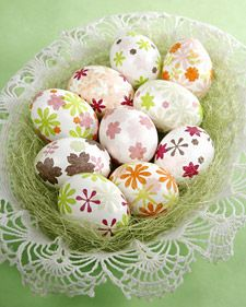 punch shapes out of tissue paper and decoupage them on the eggs