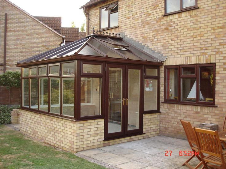 An Edwardian design in Rosewood on white with a polycarbonate roof .
