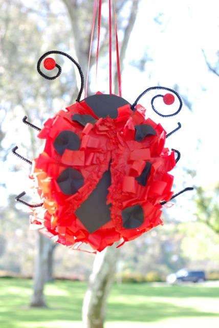 Homemade ladybug pinata.  Do I have the patience for this??  Super cute!