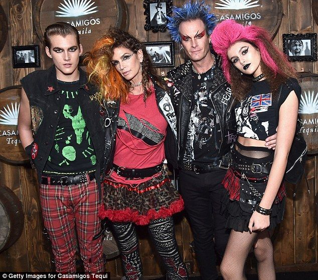 Cool fam: On Friday night Cindy Crawford and husband Rande Gerber dressed up as punk rock stars to host a Halloween party at a private residence in Beverly Hills. Also there were their model kids Presley and Kaia, who kept with the theme
